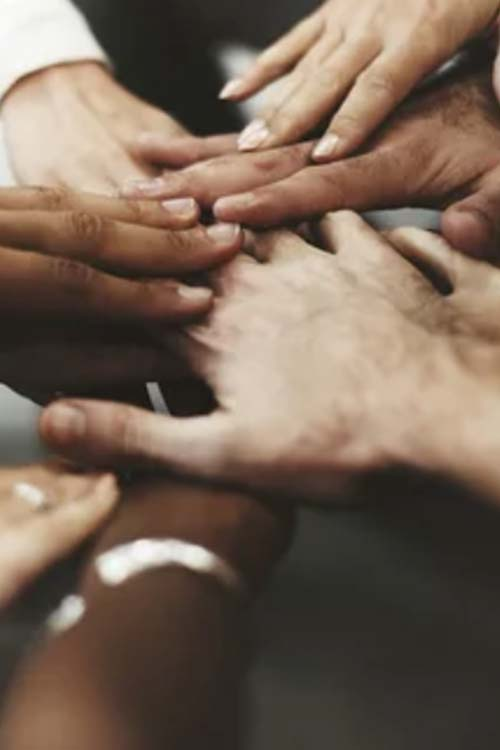 group of people's stacked hands